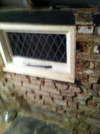 East wall of bathroom and window, with mortar cleaned from bricks
