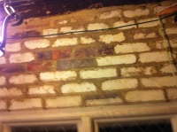 Bricks above window in south wall of kitchen, cleaned