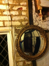 South wall of kitchen with mirror and cleaned bricks
