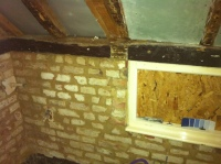 East wall of bathroom with new mortar