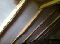 Bathroom ceiling with plaster between timbers