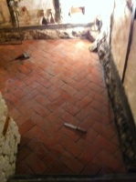 Kitchen floor with bricklike tiles, near front door