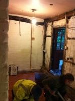 Kitchen floor being tiled