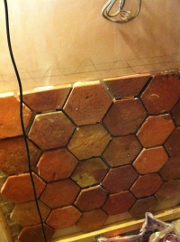 Bathroom wall with brick tiles