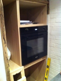 Oven and partially completed cabinets
