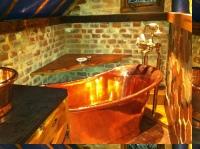Bathtub shelf behind bathtub